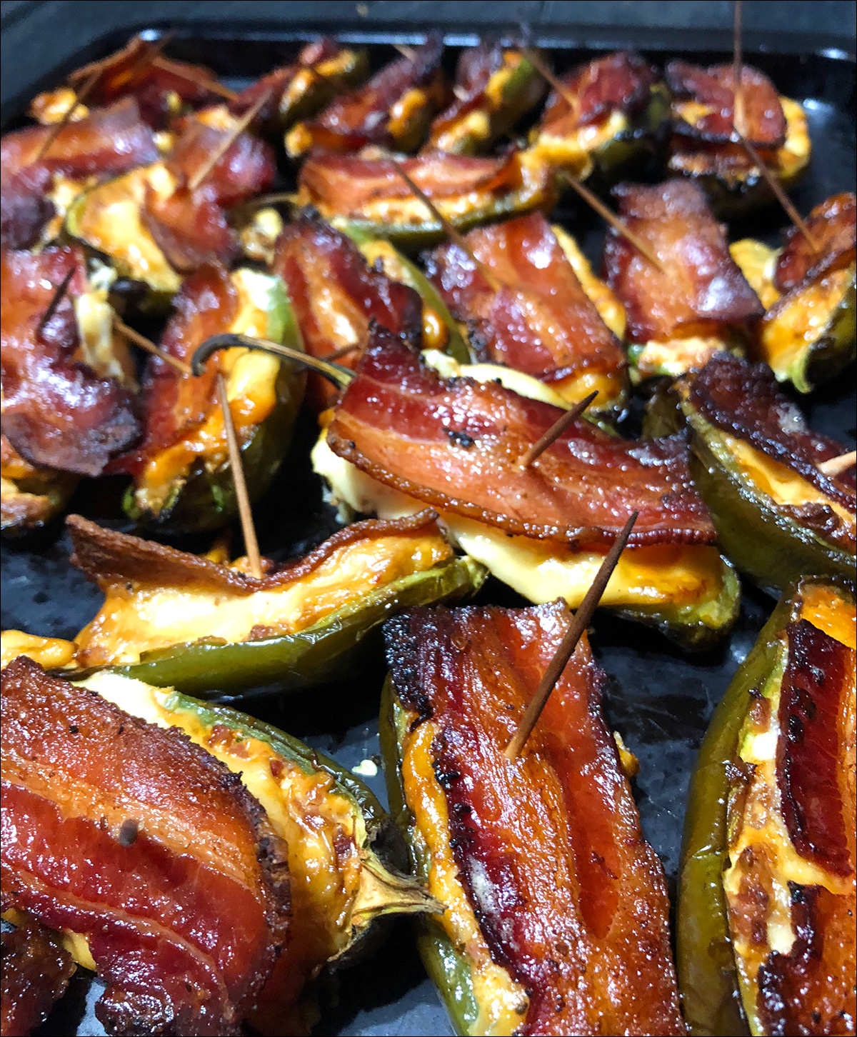 Jalepeno Poppers Bacon Slices on a Peacemaker Grill Andrew Parent